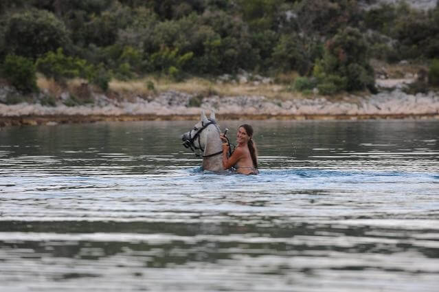 Horse riding in the lake