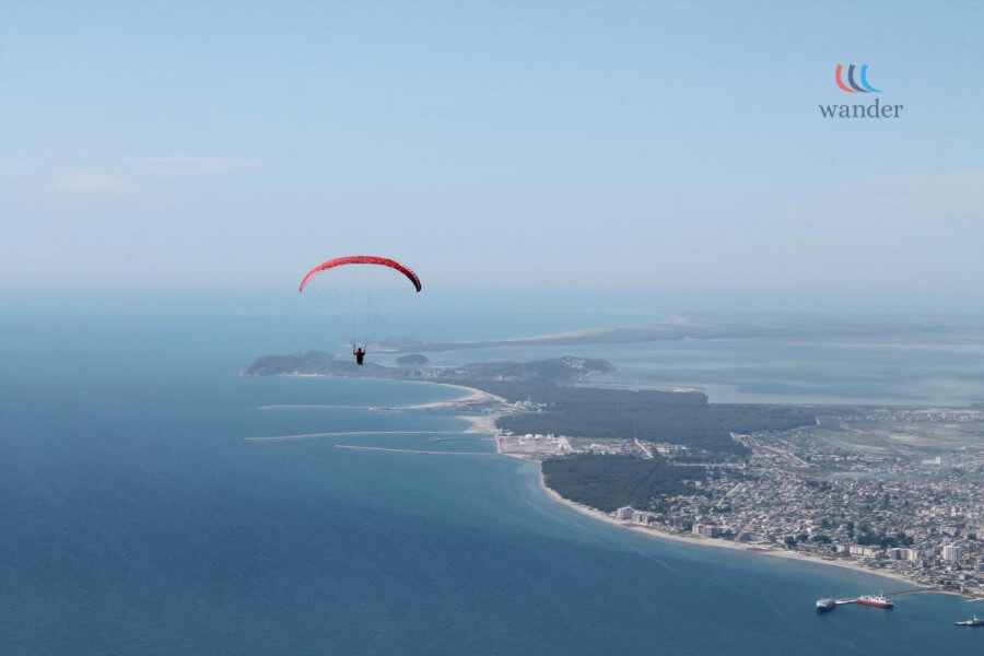 Paragliding and laying in the beach